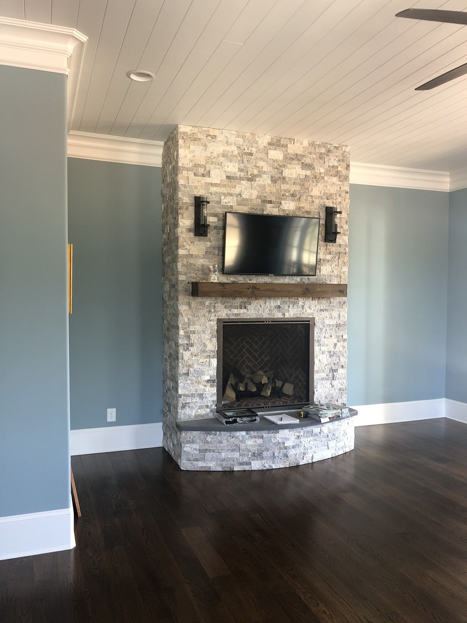 Stone fireplace in master bedroom.