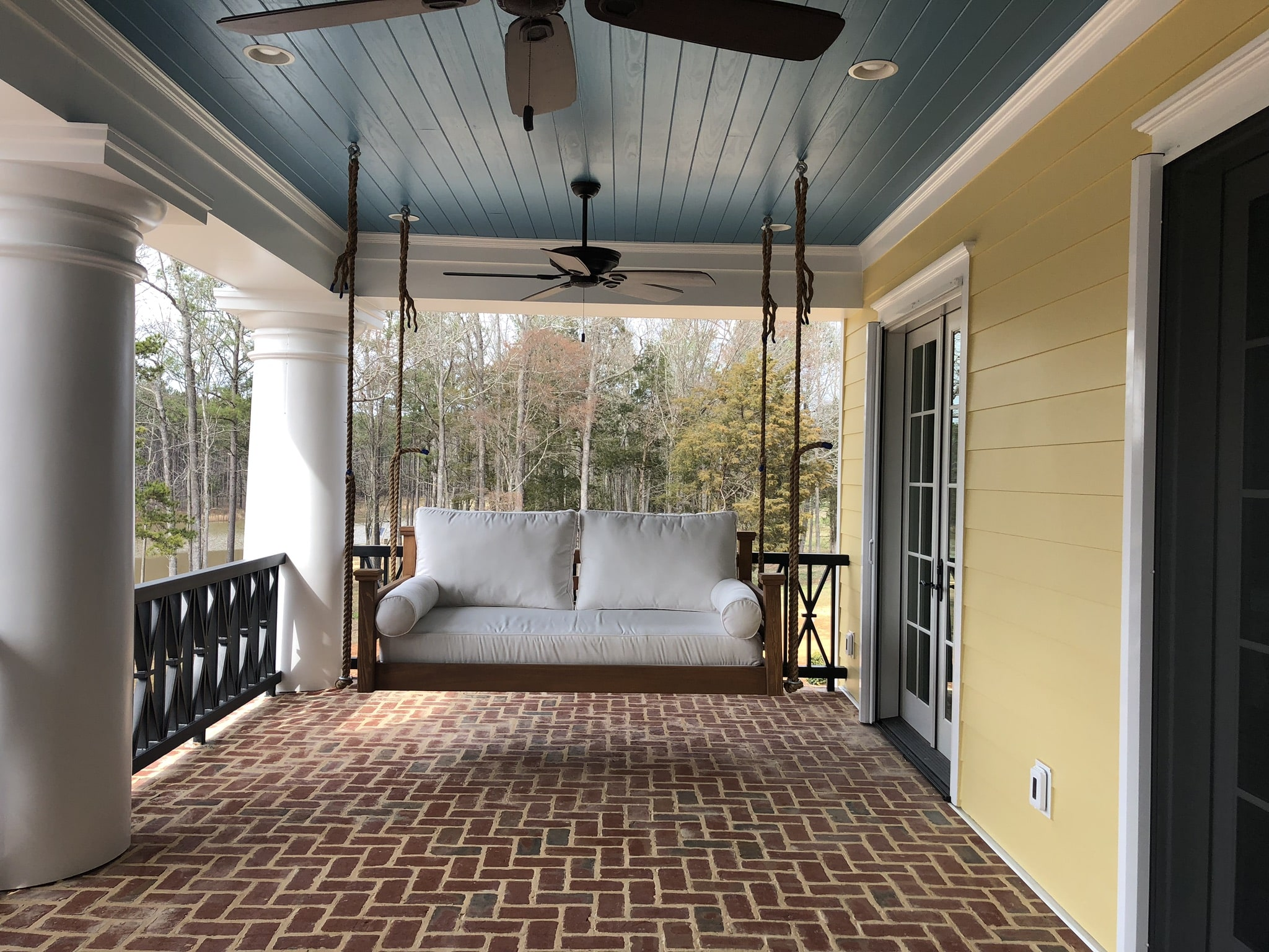 Swinging bed on second level front porch.
