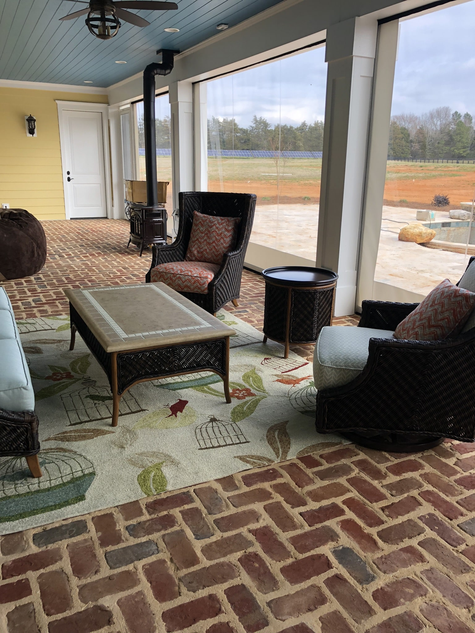 Screen porch with brick paver flooring.