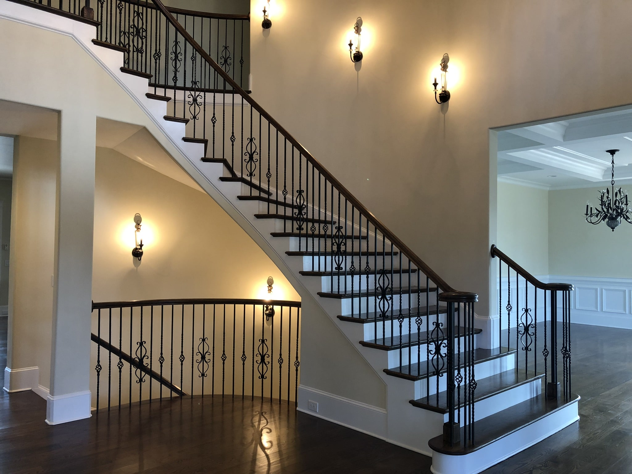 Custom curved staircase in two story foyer.