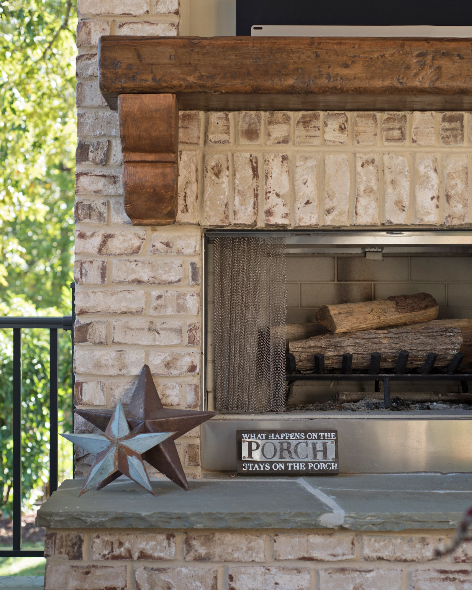 Rustic wood mantel on the brick fireplace.  We recessed a niche above to hold the TV.