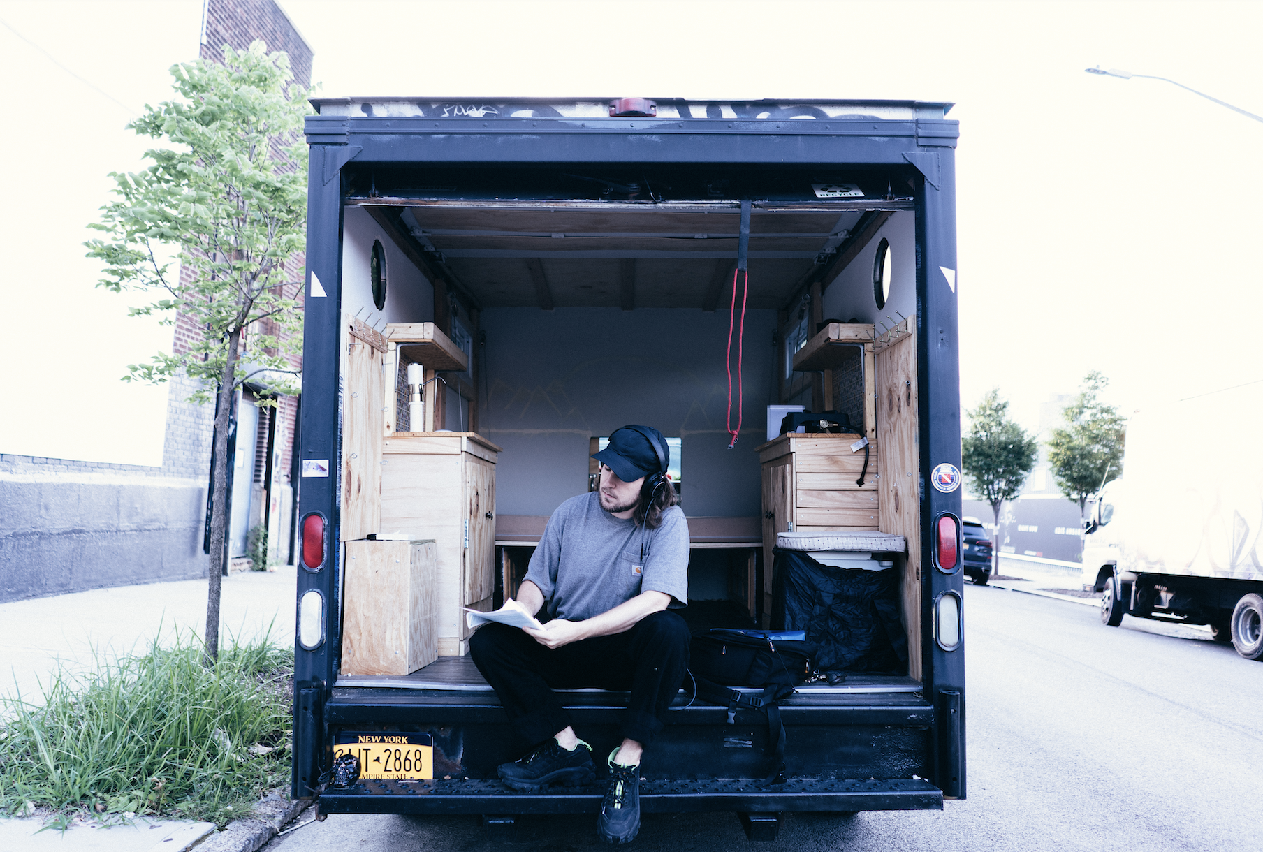 Copywriter Drew Botcherby, getting some work done in his recently purchased conversion van.