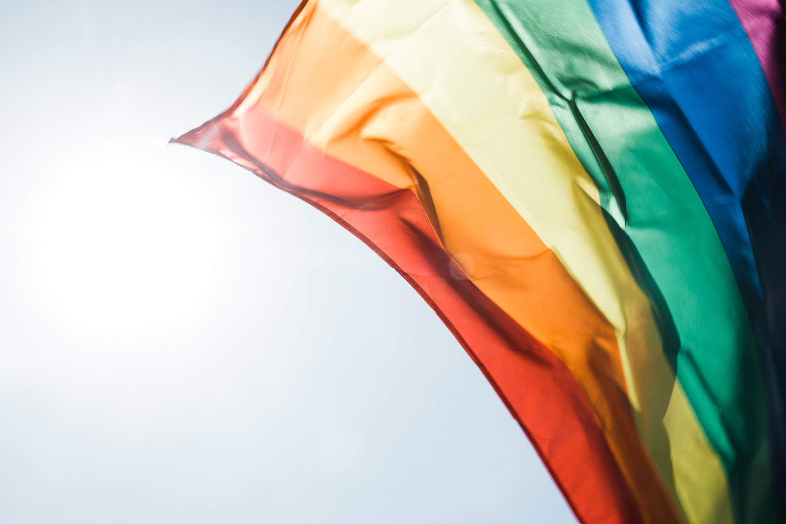 Rainbow flag flying in the wind.