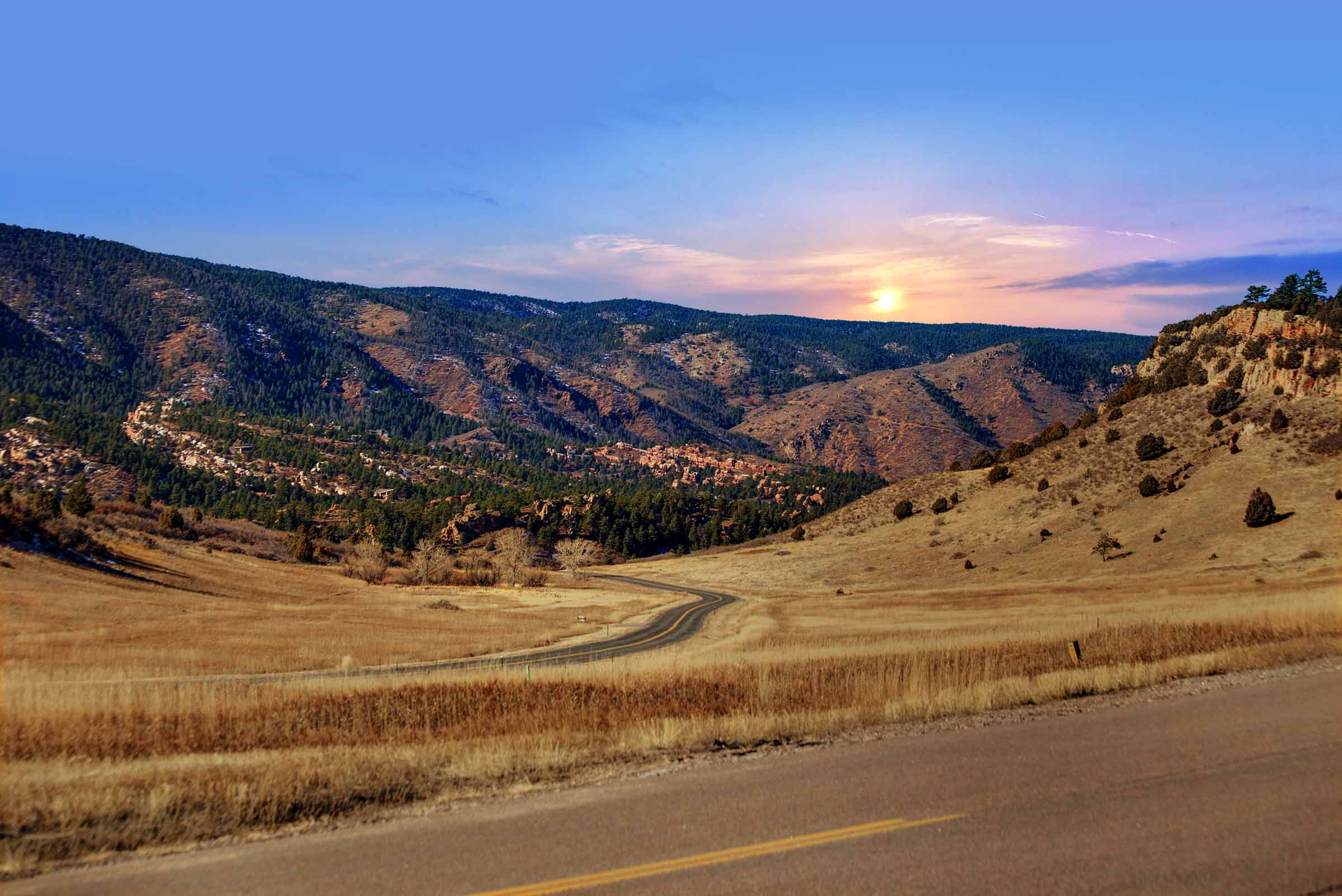 Larkspur, Colorado - Established and new custom home neighborhoods along with large ranch and acreage properties weave together through forests of ponderosa pines, red rock spirals, and wide open spaces to create this exceptional place to live.