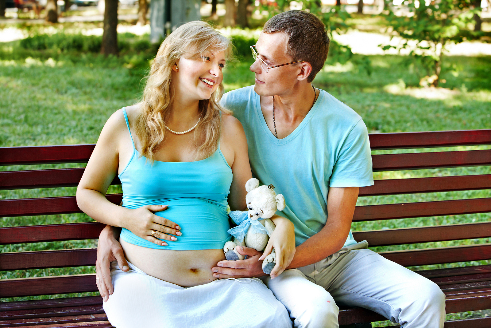 bigstock-Pregnant-woman-with-man-holdi-50269973.jpg