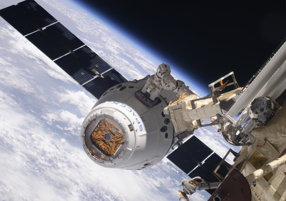 2018-12-08-12_06_22-Dragon-CRS-14-Arrives-at-ISS-after-Textbook-Rendezvous-for-Critical-Science-Deli.jpg