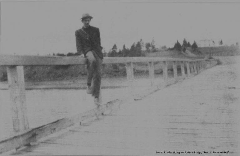 Everett Rhodes sitting on Fortune's wooden bridge.