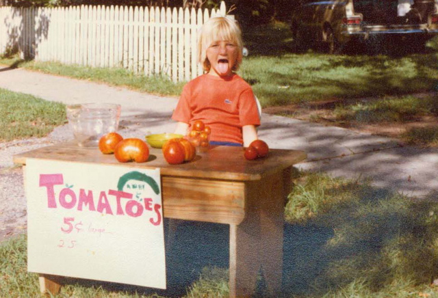 youngchef-abigail-hitchcock-at-a-tomato-stand-she-made-sticking-her-tounge-out.jpg