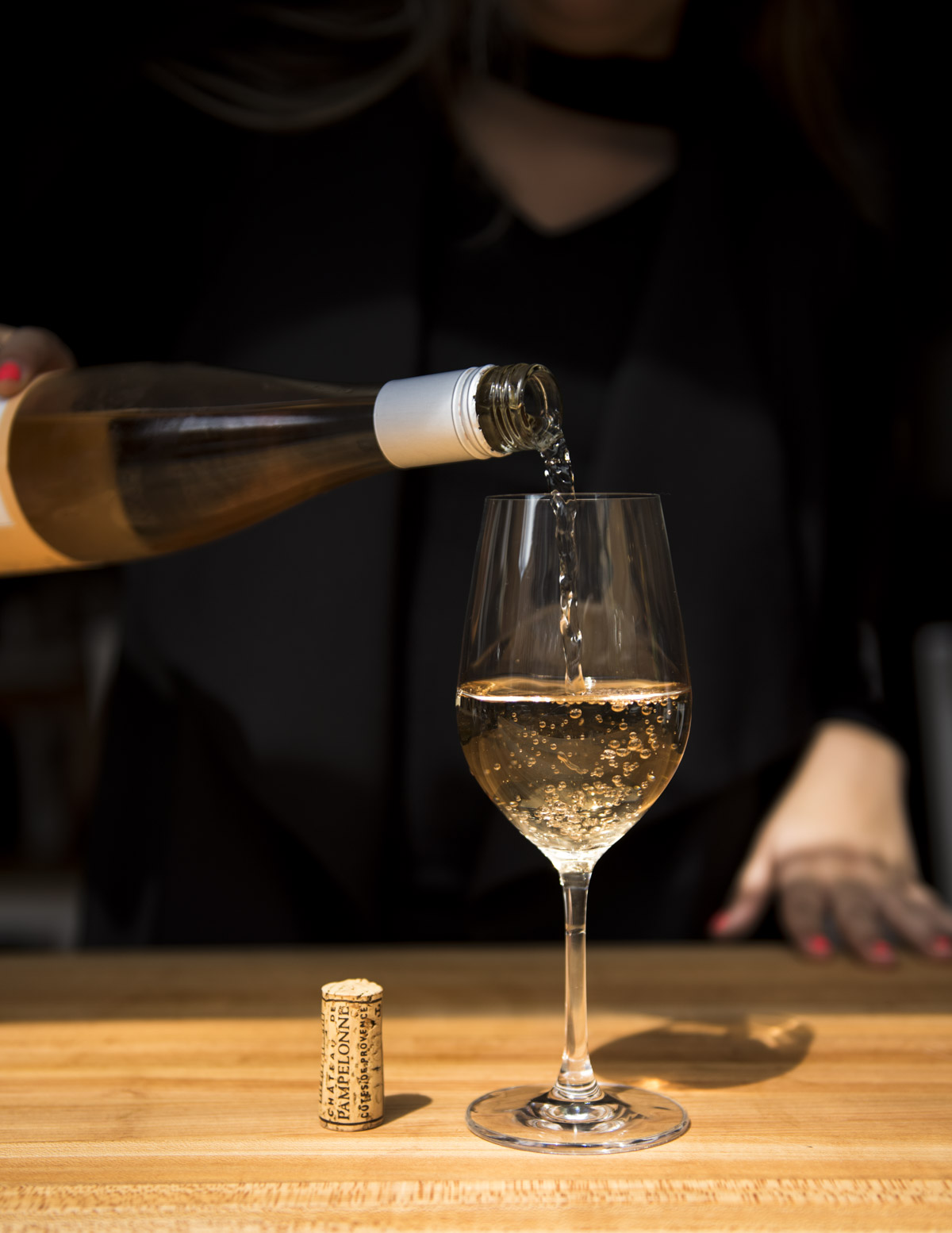 sidephoto-person-pouring-whitewine-into-wine-glass.jpg
