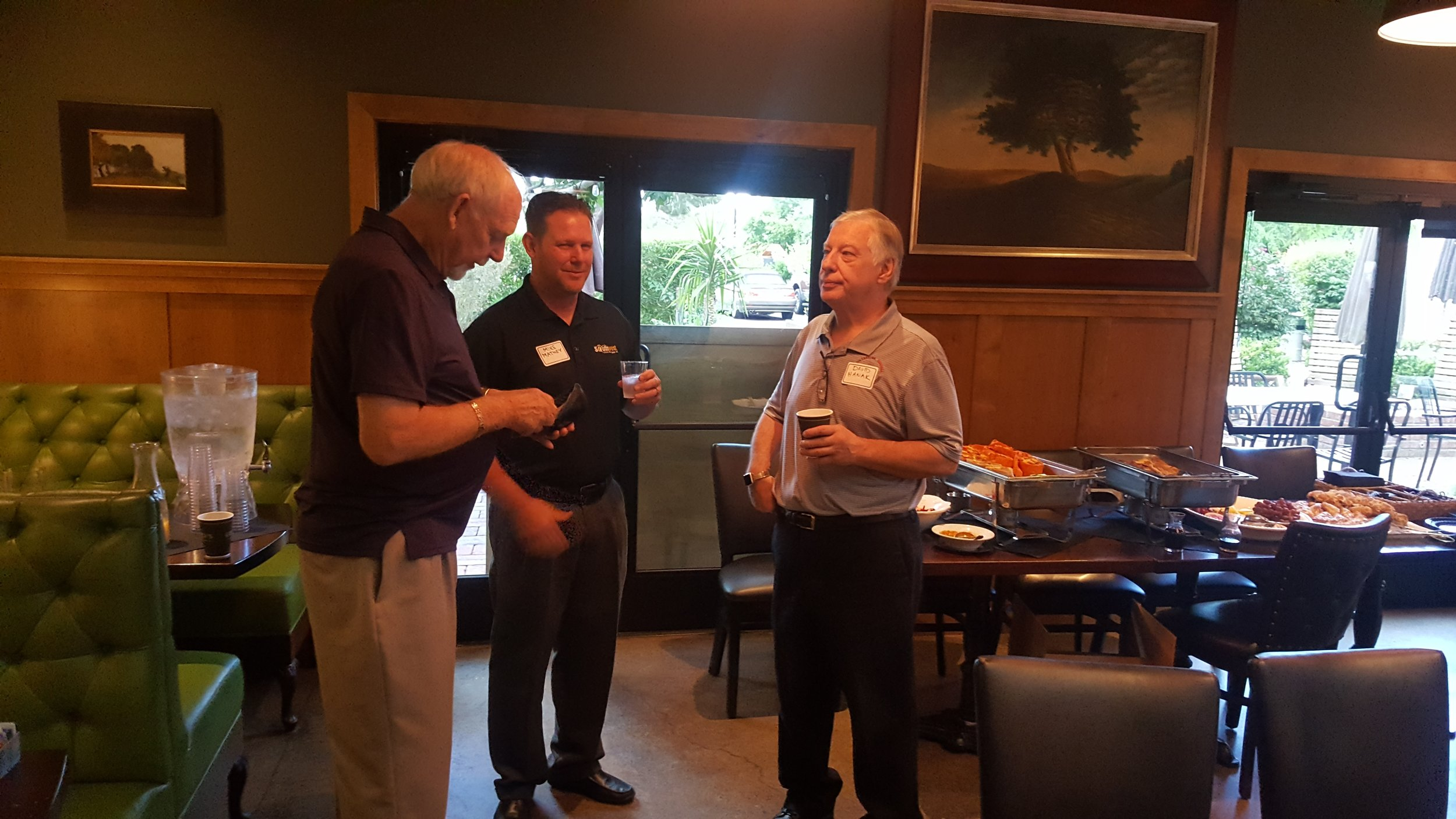 Greetings - Dave Hanek, PA Chi Omicron '79 (R) visits with Bill Wienke, TX Alpha '60 (L) and Mike Matney, MI Alpha