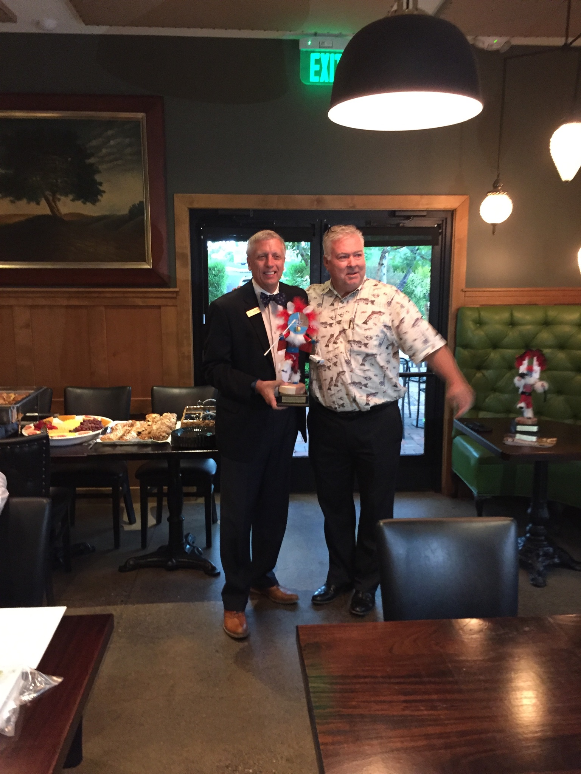 Greg Gillis, Big Chief Kachina! - Stan Strom congratulates Greg Gillis for his past service as President of the SAE Phoenix Alumni as he accepts his Big Chief kachina award.