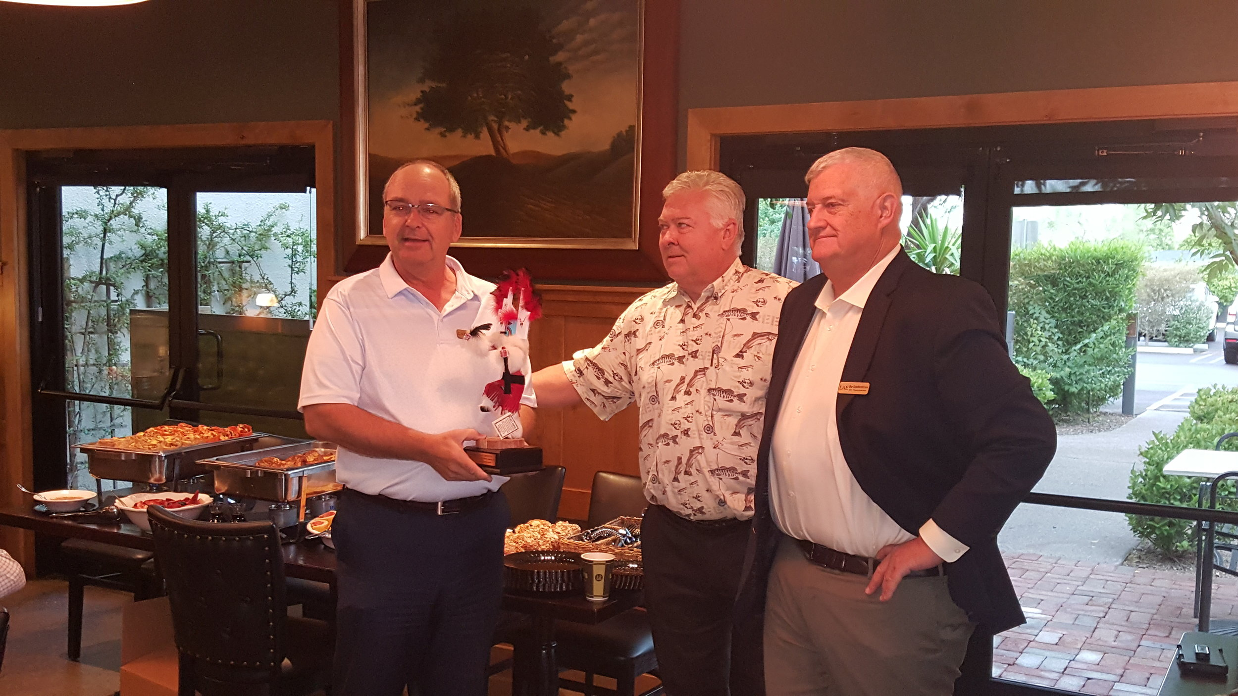 Todd Stingley, Harvest Kachina! - Past President Todd Stingley, NE L-P accepts his kachina award from Stan Strom, AZ Beta '82 and current President, Bo Sederstrom, AZ Gamma for his past service as President of the SAE Phoenix Alumni, Inc.