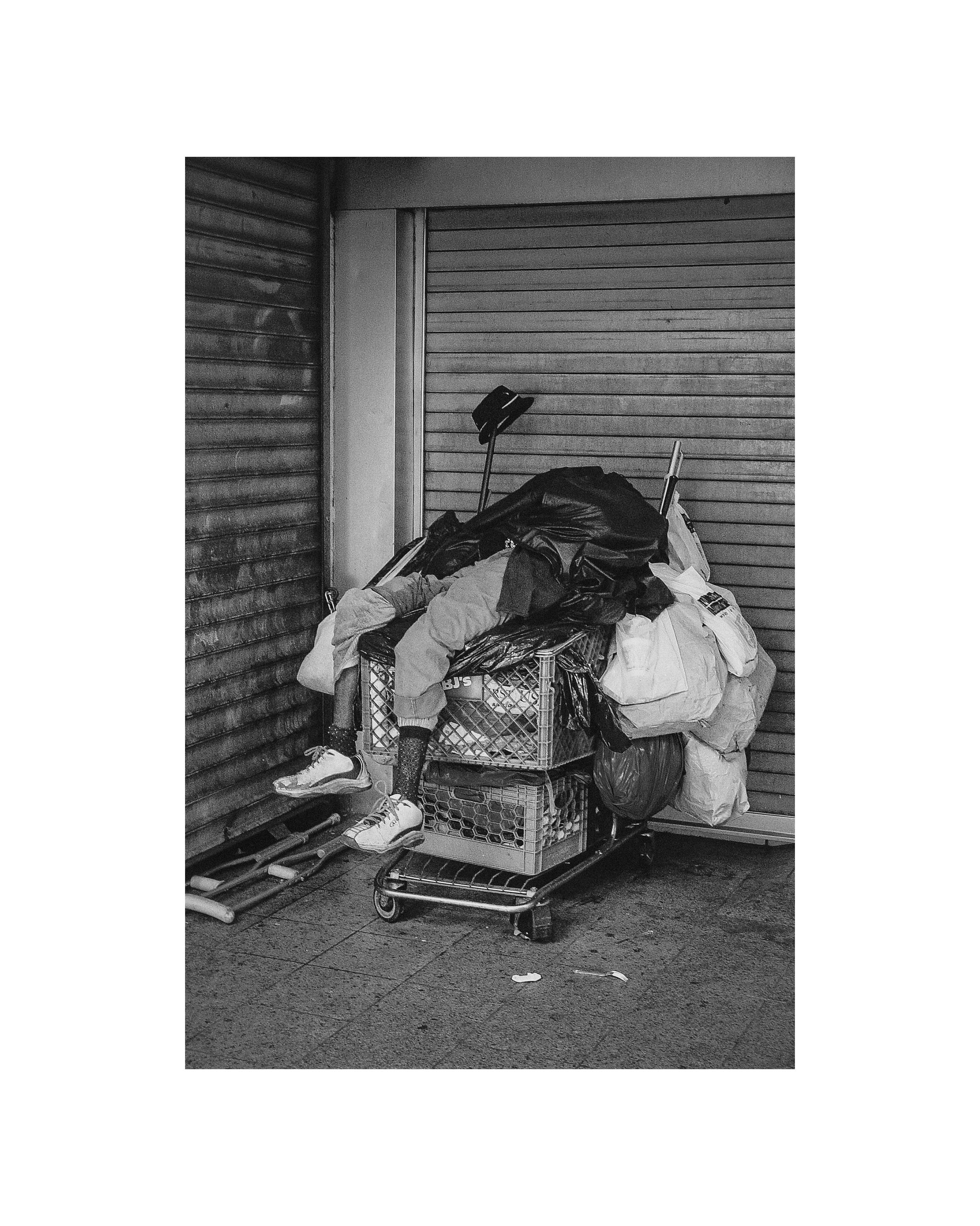 shane_deruise_alleyways_man_sleeping_on_cart.jpg