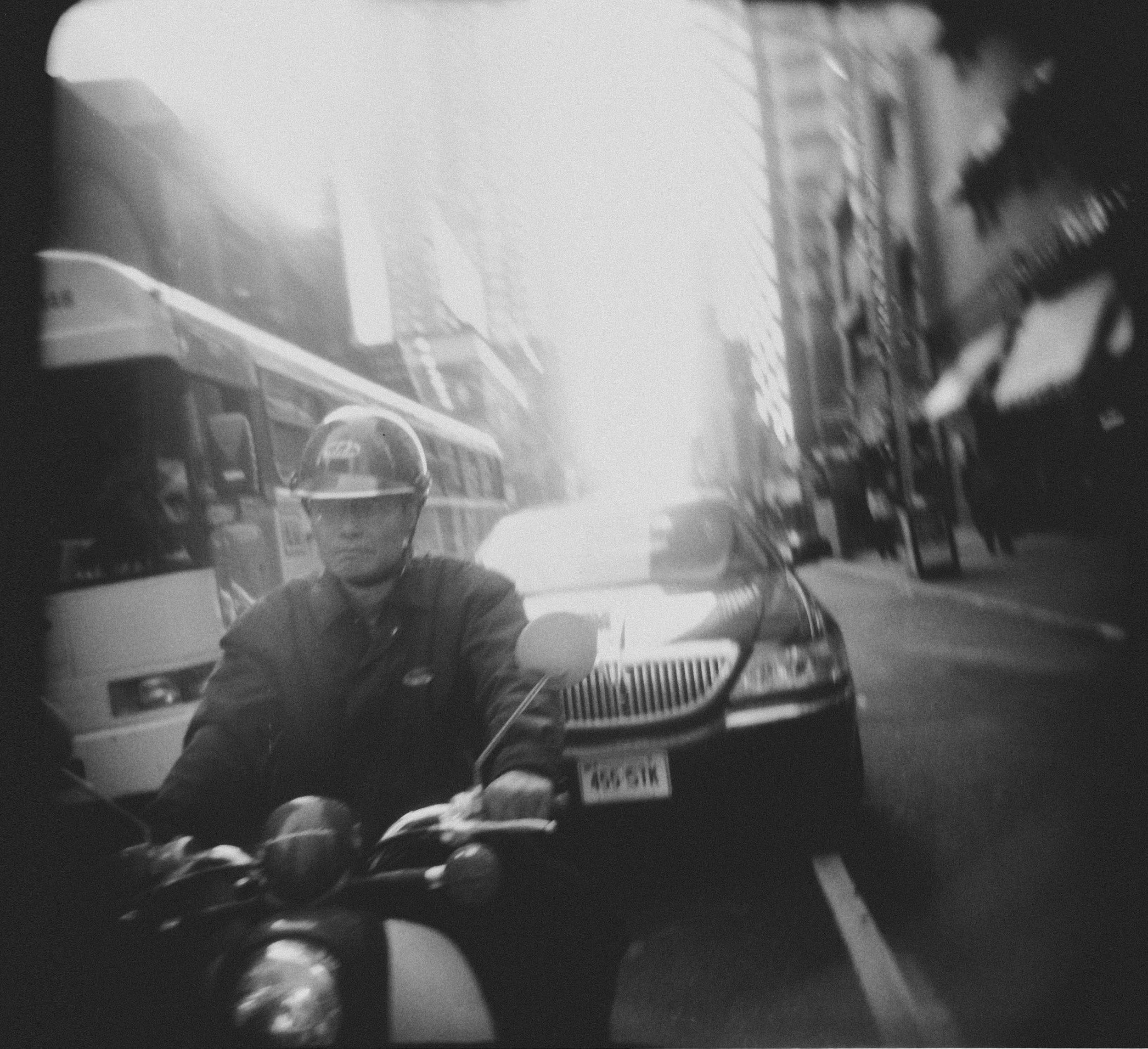 shane_deruise_alleyways_man_moped_holga.jpg