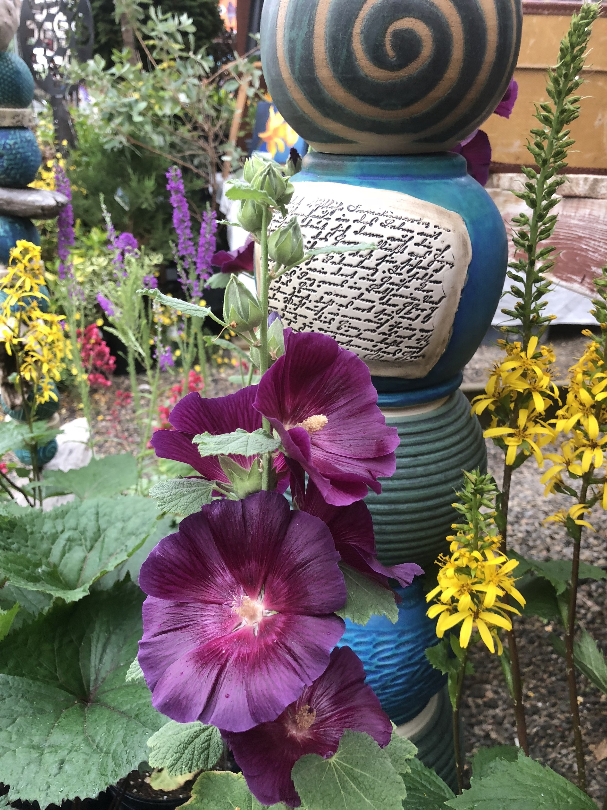 CLAY IN THE GARDEN - My garden is an experiment in community building. From the pollinator gardens to the now mature food forest that provides food for our family and beyond