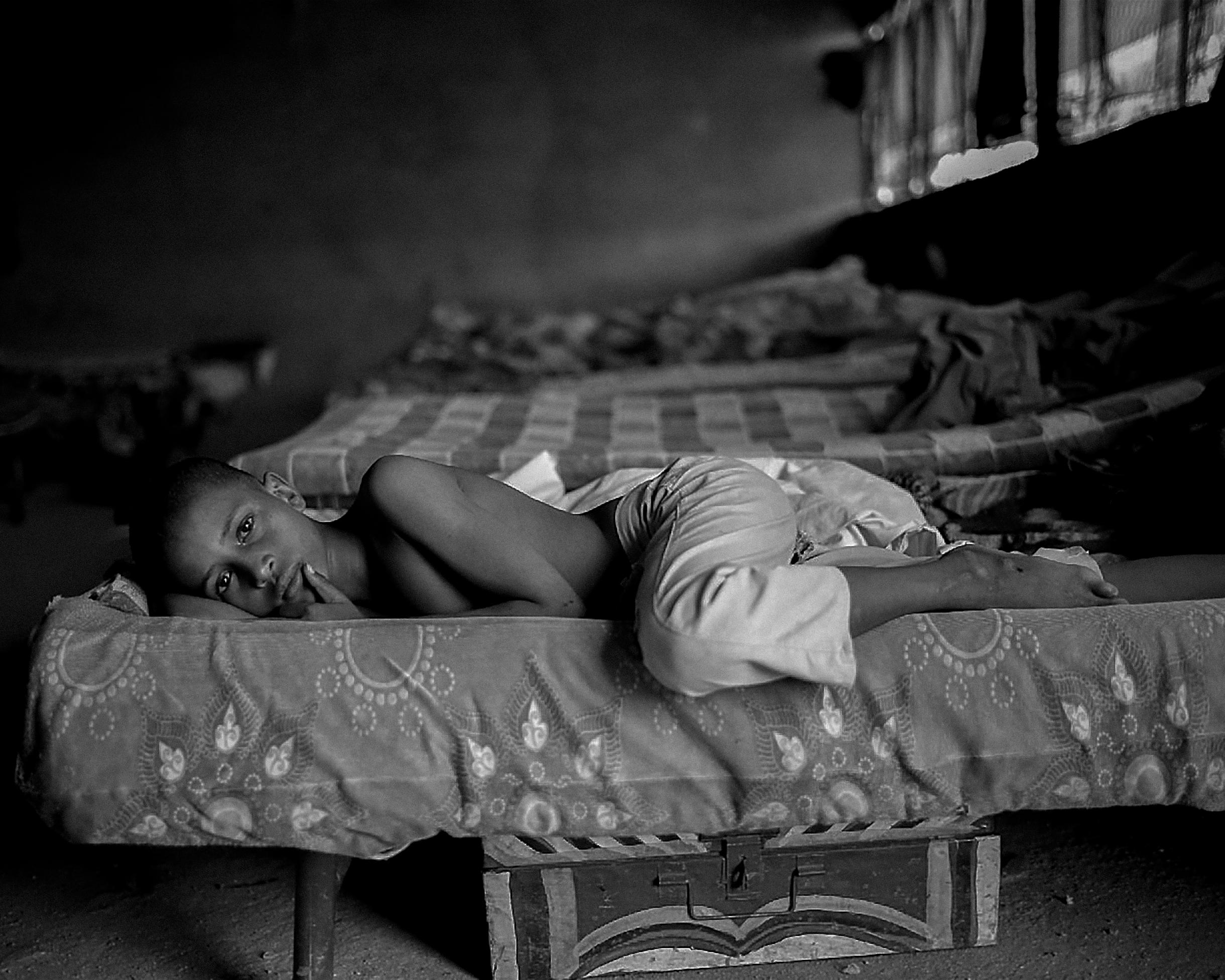 A sick child in a Koranic school