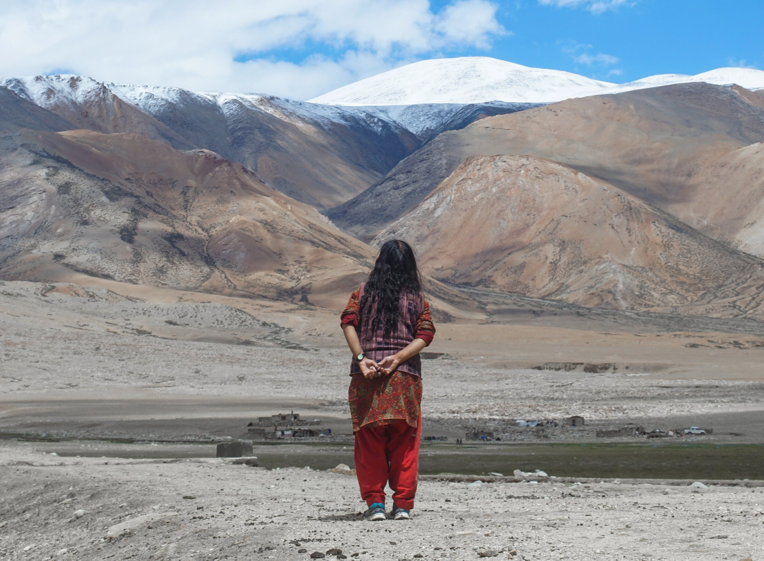 Dolma looks in the horizon and notices the changes in the Himalayan peaks.