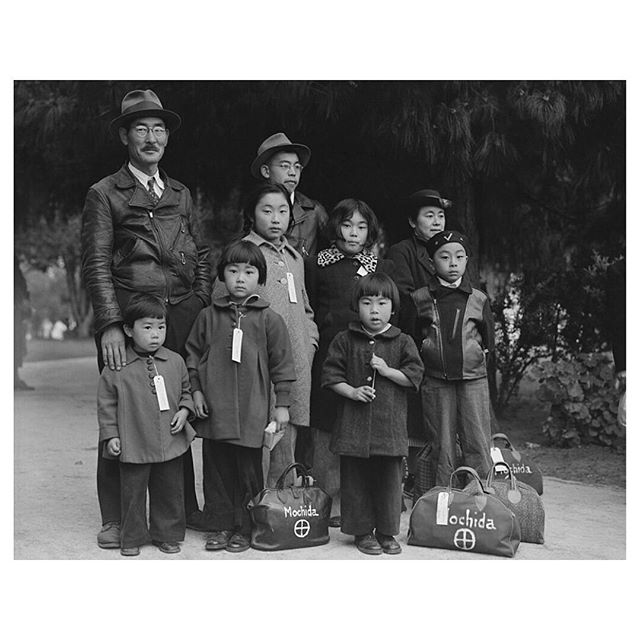 """Reflecting on his own grandparents' experience, Derek Tahara explores the troubling comparison between the state of the Japanese internment camps during World War II and the concentration camps at the US-Mexico border. . 🔗 """"They shared with me the gruesome details regarding their cramped sleeping arrangements and meager portions of food. But at the same time, they did not fully grasp the situation due to their youth."""" . . ☞ Click the link in bio to read the full article """"A concentration on change"""" by Derek Tahara: https://www.thejfa.com/blog-1/a-concentration-on-change . 🎞 Original caption: Hayward, California. Members of the Mochida family awaiting evacuation bus. Identification tags are used to aid in keeping the family unit intact during all phases of evacuation. Mochida operated a nursery and five greenhouses on a two-acre site in Eden Township. He raised snapdragons and sweet peas. Evacuees of Japanese ancestry will be housed in War Relocation Authority centers for the duration. Dorothea Lange - U.S. National Archives and Records Administration"""