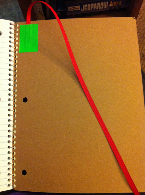 Tape a short ribbon in the back of the interactive notebooks that can be used to mark where they left off, like a bookmark.