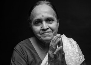 "KUSUM - At the age of 40, Kusum Modak had two meetings that would completely transform her life: the first was with B. K. S. Iyengar, one of the most recognized yoga masters in India and worldwide. Kusum became Master Iyengar's disciple, thus initiating a disciplined path, and practiced for more than 20 years at his institute in Pune, Maharashtra in India.The second meeting, which was a milestone in Kusum's life, was with Mr. Limaye , a simple man with deep knowledge of the art of massage.With great sensitivity and wisdom, he sparked a powerful healing force in Kusum by introducing her to the ways of massage. For a year and a half Kusum accompanied him daily, watching amazing healings. In many cases, the people had long histories of trying various treatments and surgeries. Thereafter, Mr. Limaye put Kusum on intensive practice under his supervision, and before he died, he professed: ""I am sure that you will develop this work and spread it to the world,"" and he was right!Kusum inherited from her master an honest, direct and clear way to express herself by sharing this treasure that is a blend of simplicity and sophistication. Kusum, as the Hindu tradition of 'Parampara"" (direct transference from Master to disciple) has appointed Laura Branco as the continuation of her legacy training therapists in India and the world. During Laura's trainings in India Kusum comes to meet us, bless and spark us with her fiery spirit."