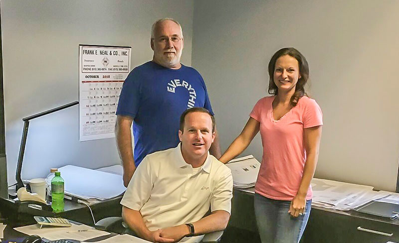 Estimator and Project Coordinator Dana Mitchell (back left), Estimator and Project Coordinator Andrea Fall (back right) with Partner Joey Rhyne (seated).