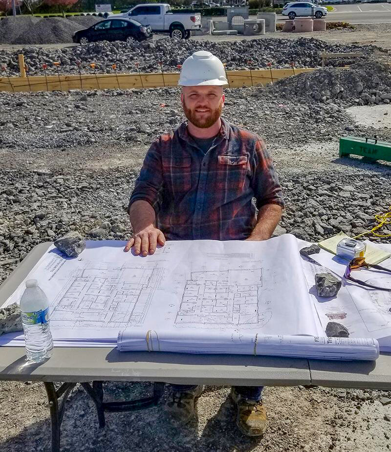 Zac Neely works on his first project as a new Project Superintendent at Dow Smith Company.