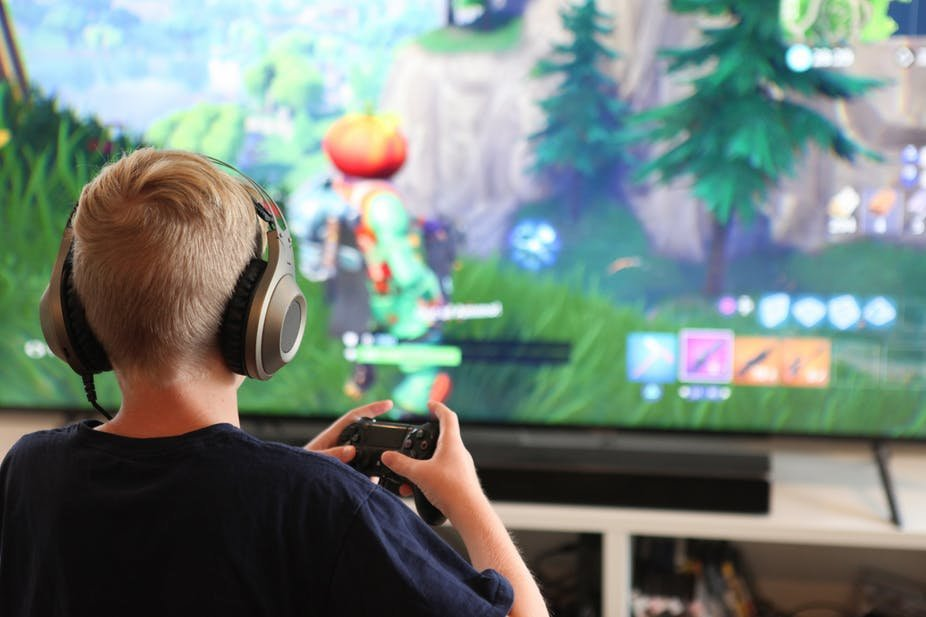 Boy playing Fortnite (Credit:  Jennie Book/Shutterstock )