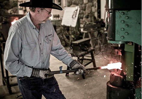 Jerry Fisk, one of the premier bladesmiths in America, in his studio In Arkansas. Image credit: Tadd Myers