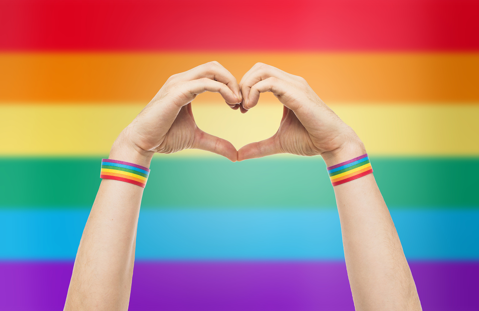 Hands making a heart over a rainbow flag | Gender Counseling | Tulsa, OK 74008