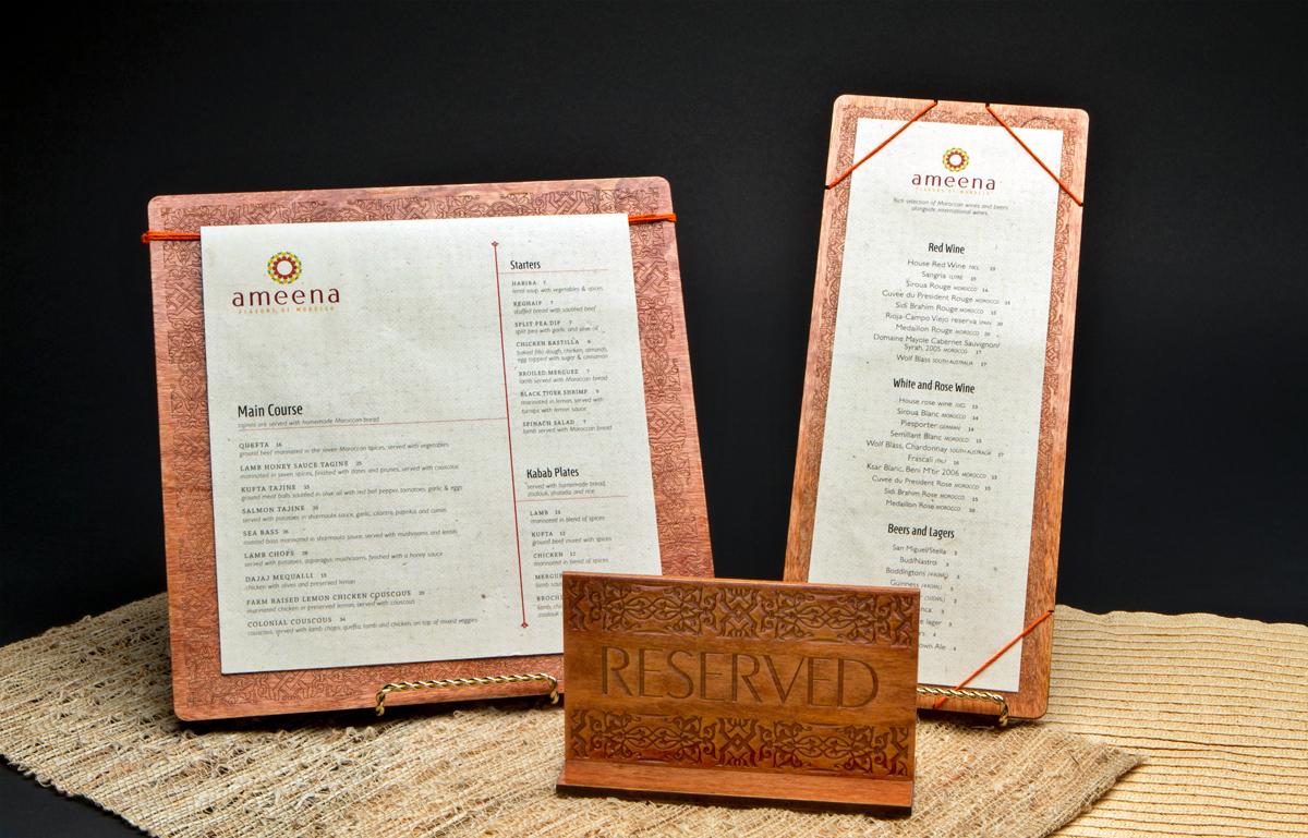 "Dinner menu, drink menu and ""reserved"" signage."