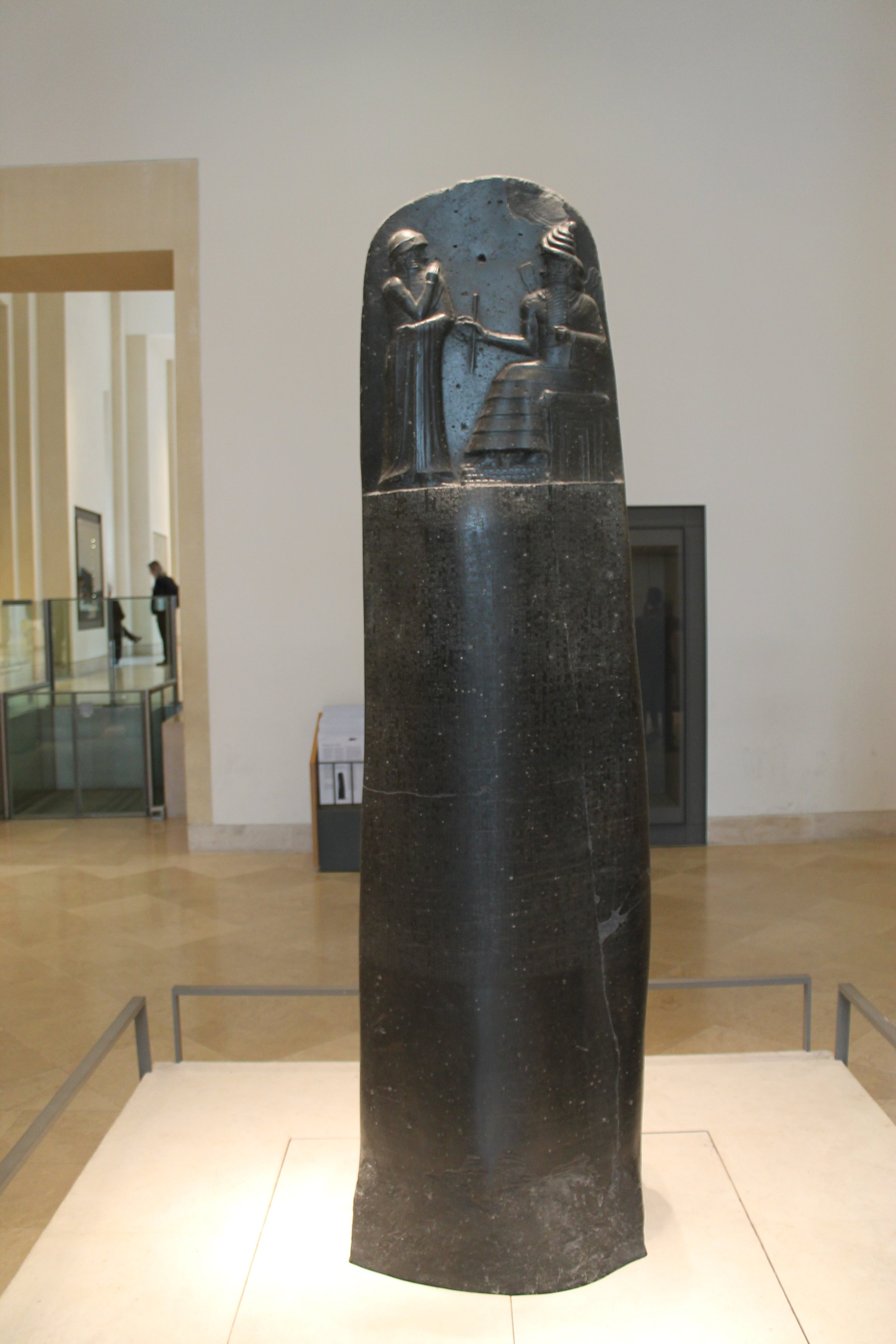 Code of Hammurabi, dating to 1754 BC, constructed under the orders of the 6th Babylonian king Hammurabi. It is 2.25 m (7.4 ft) tall contains text written in the Akkadian language using cuneiform script carved into the diorite stele. It consists of 282 laws (credit: Photo by K. F. Long, located in Louvre, Paris).