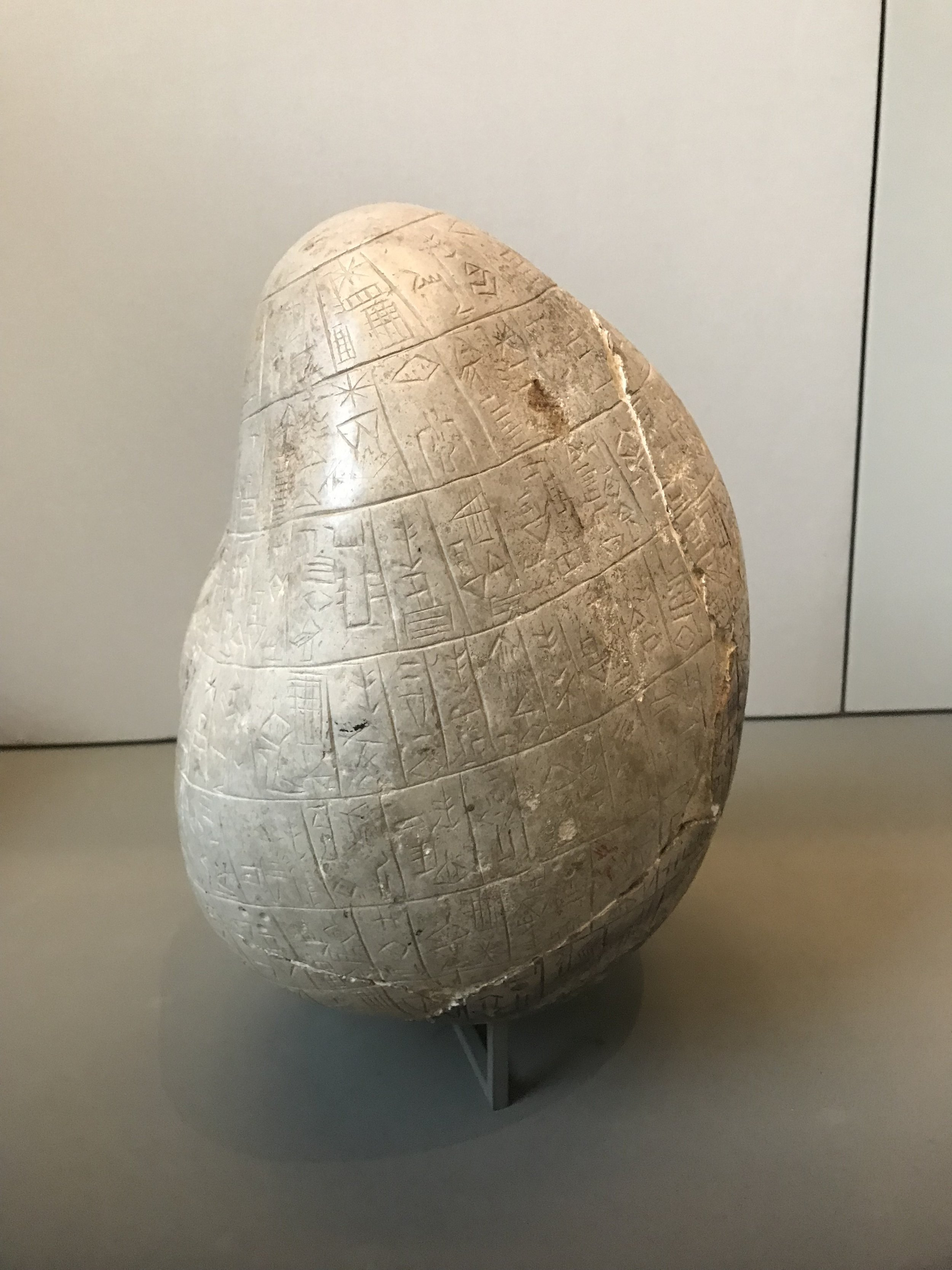 An artefact observed to contain much cuneiform written text in addition to logograms, which illustrates what such a minilithic artefact may look like. (image credit: K. F. Long, located at the Louvre, Paris)
