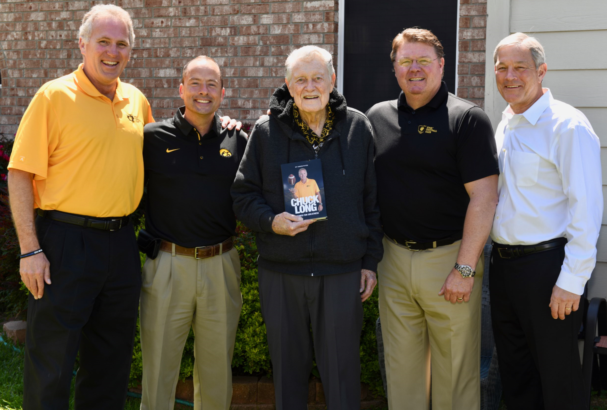 Destined for Greatness book presentation to Coach Hayden Fry (from left): Chuck Long, Aaron Putze, Coach Fry, Hap Peterson, Kirk Ferentz (April 2018).
