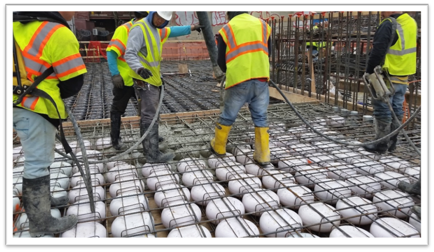 Placing the Initial Concrete  — Vibrating concrete in this first step in concrete placement secures voids, prevents void buoyancy, and ensures the integrity of the grid.