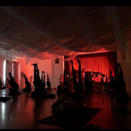 Black Market Yoga - students in shoulderstand