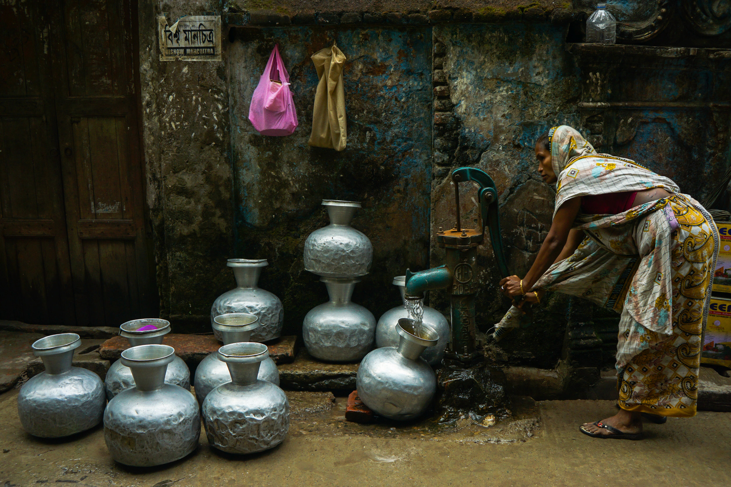 Kazi Mushfiq Hossain. Water Collecting From Street. Courtesy Pink Lady Food Photographer of the Year.