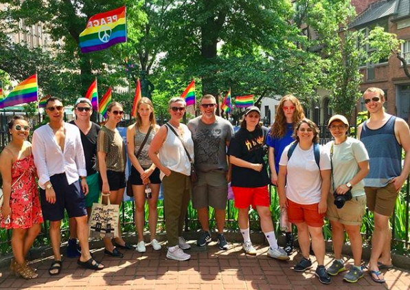 Tour Group in front of Pride flags