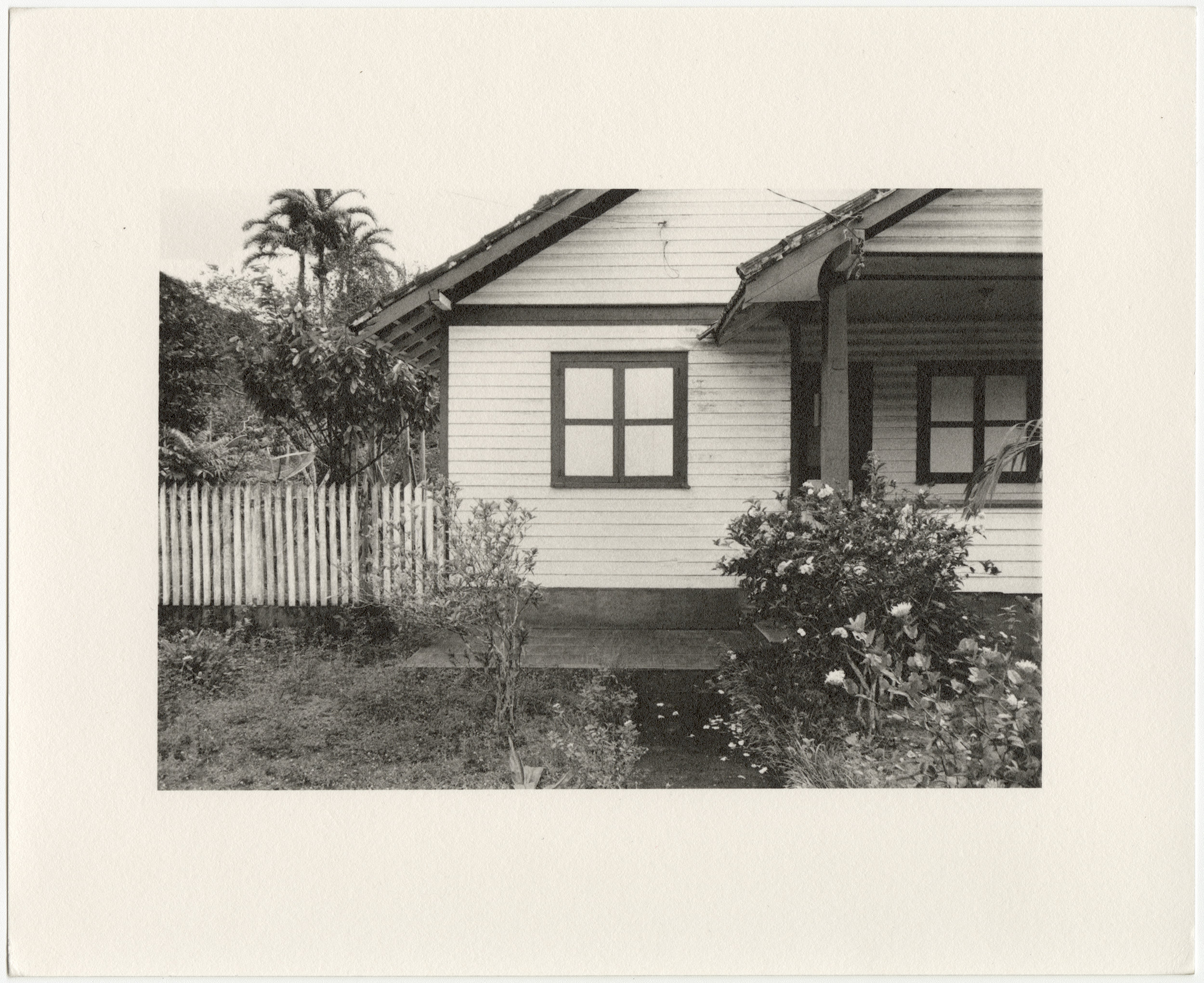 "Belterra employee house with window and white picket fence, built in 1934 by the Companhia Ford Industrial Do Brasil Ford Motor Company. 2014 Belterra, Pará, Brazil. Gelatin silver fiber print, 8"" x 10"", 2014/2018"