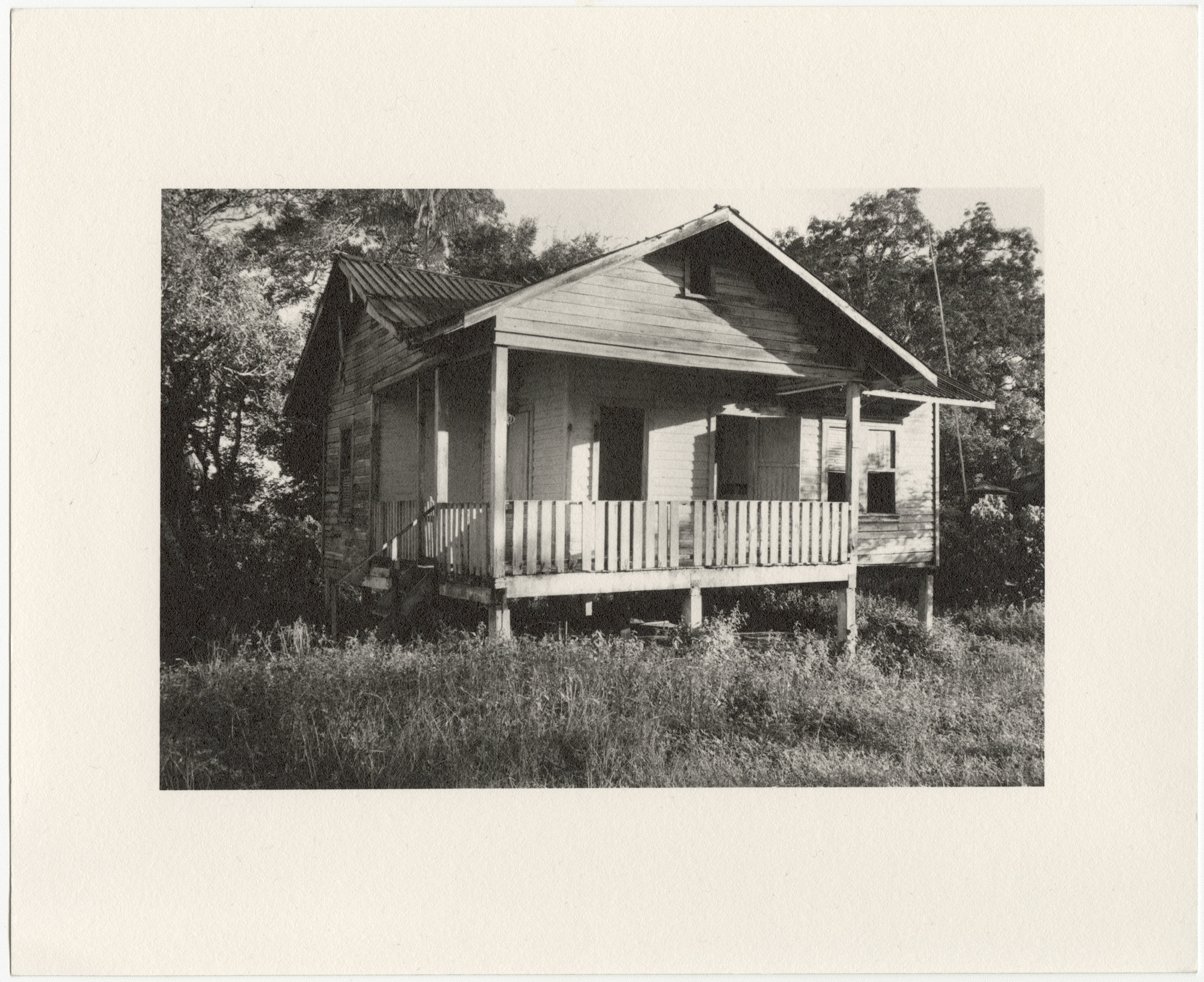 "Fordlândia employee house with elevated front porch, built in 1929-1933 by the Companhia Ford Industrial Do Brasil Ford Motor Company. 2014 Fordlândia, Pará, Brazil. Gelatin silver fiber print, 8"" x 10"", 2014/2018"