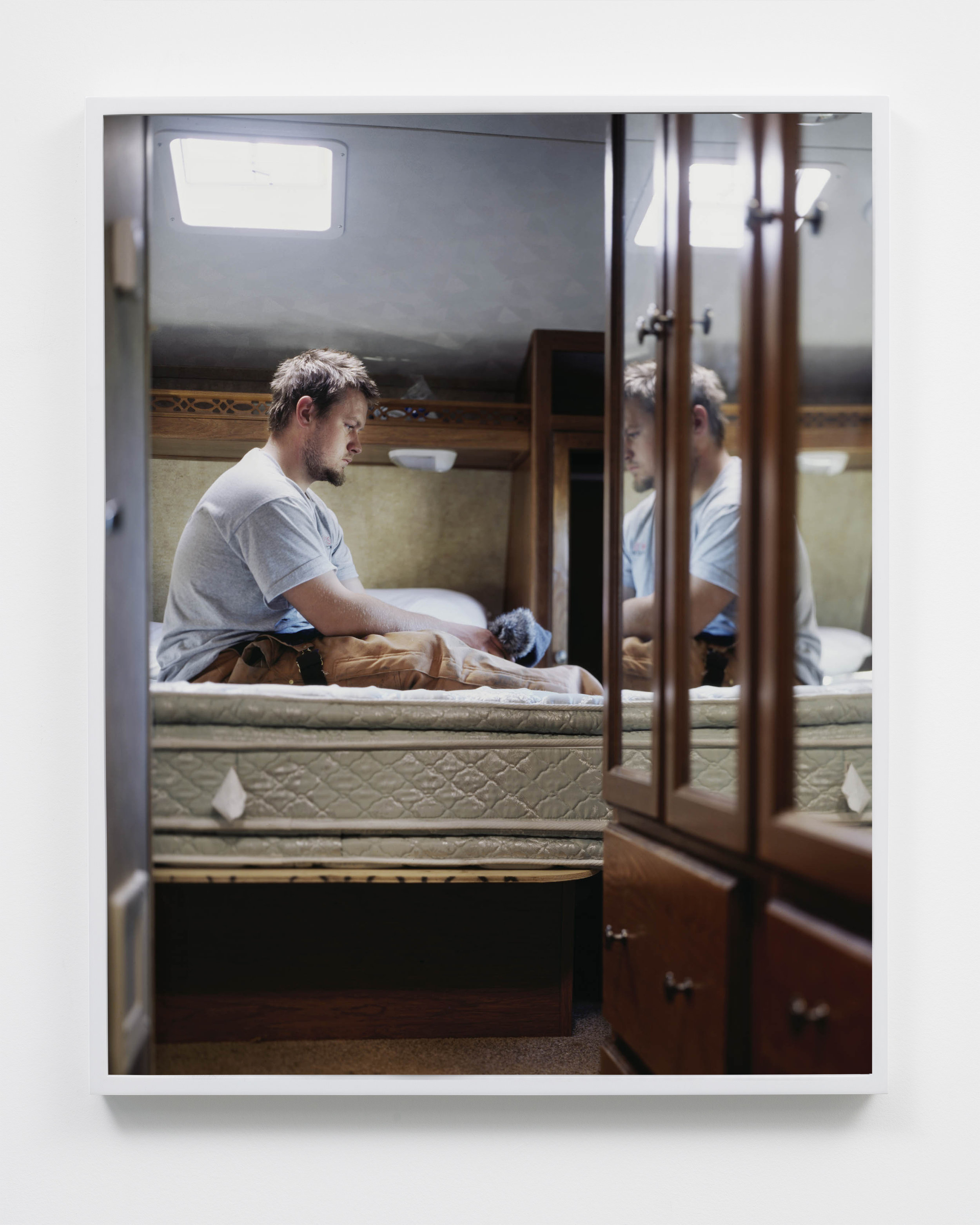 Matthew, oil field worker in trailer at Walmart parking lot, Williston, North Dakota, 2011.
