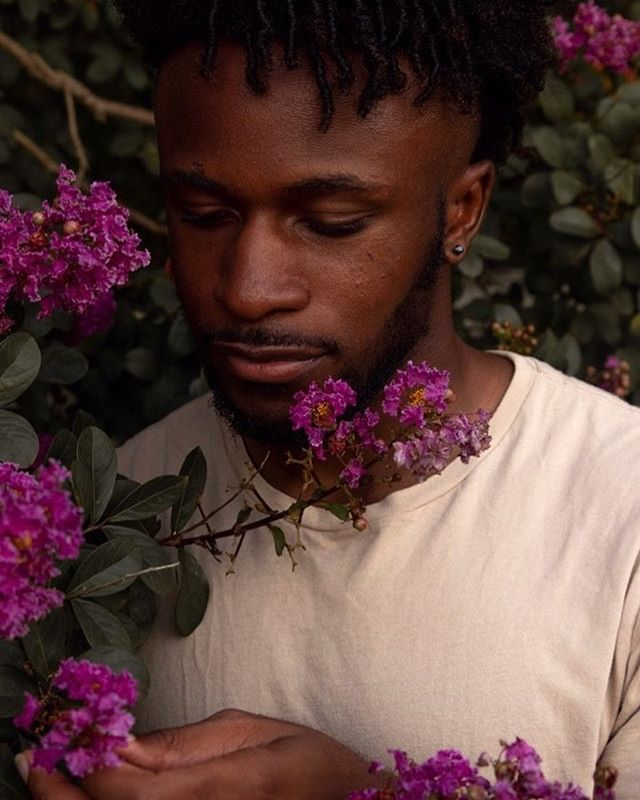 I love playing with 🌺. I think it's so important to show Black people in these lights of gentleness because the world tries to blanketly apply violence and hardness onto us. I refuse to reinforce that when making photos. . . . . . . . #Photooftheday #blackjoy #celebration of life #arthoe #artheaux #blk #retroswilliamsburgn#selflove #csfulgham #darkskinman #tropicalflowers #blackboimagic #blackmen #blackphotographer #tenderness #flowers #floral #blackinnature #nature #earthing #grounded #ancestors #veneration