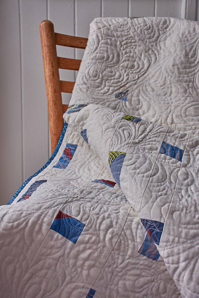 Silk, cotton, and linen quilt with coconut buttons