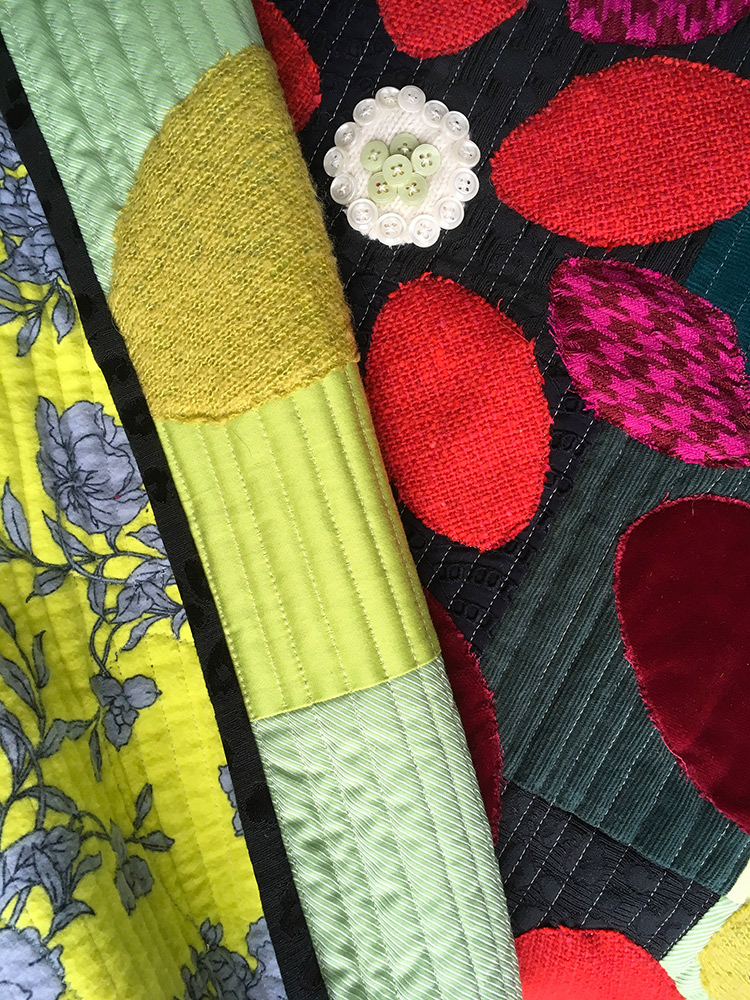 Quilt in wool, cotton, velvet, eyelet, cashmere, and corduroy with floral flannel backing and wool batting