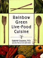 """Rainbow Green Live Food Cuisine by Gabriel Cousens, M.D. - Paperback: 544 pages Size; North Atlantic Books; (March 2003)In developing the understanding that there is no one diet for everyone and pursuing a scientific means of individualizing one's diet, Rainbow Green Live-Food Cuisine merges the wisdom of the Ayurvedic dietary approach with modern research on metabolic factors such as fast or slow oxidation; blood type; genetic make-up and morel. Learning how to select a diet that fits your unique constitution is the key to health and balance.The prevalence and dangers of foods that have been genetically engineered; commercially grown with pesticides, herbicides, and hormones; irradiated, microwave, or even (just) cooked are also addressed. Rainbow Green Live-Food Cuisine is the most practical solution to these critical personal and planetary issues. This compelling synthesis of research and innovative dietary strategies charts new territory based on an age-old theme; Eat as nature intended.In the first part of this highly informative book Gabriel Cousens discusses the health benefits of following a live-food diet. The second section of the book which is over 300 contains delicious live-food recipes by the chefs at the Tree of Life Cafe. These restorative """"live"""" foods can reverse chronic disease and bring back health and vitality.These revolutionary recipes do more than stimulate your palate. Properly understood, they enhance your understanding of the biological terrain of the body and mind and the process of attaining optimal health and expanded consciousness. The authors of Rainbow Green Live – Food Cuisine have created the first sophisticated, gourmet, multinational cuisine based on natural, organic, living food.Contains 250 delicious vegan recipes such as Avocado Salad with Rosemary, Green Dragon Broccoli, Raw-violis, Lavender Milk, Carob Coconut Cream Eclairs, juices and an assortment of International entrees. The dishes range from easy to prepare to fairly com"""