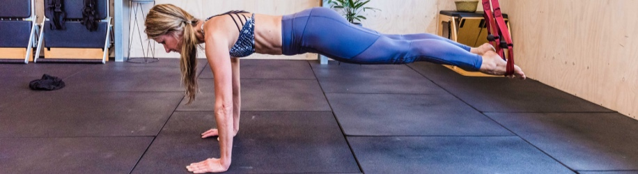 The plank can be modified to suit all bodies. If you have sore wrist, drop to your elbows.