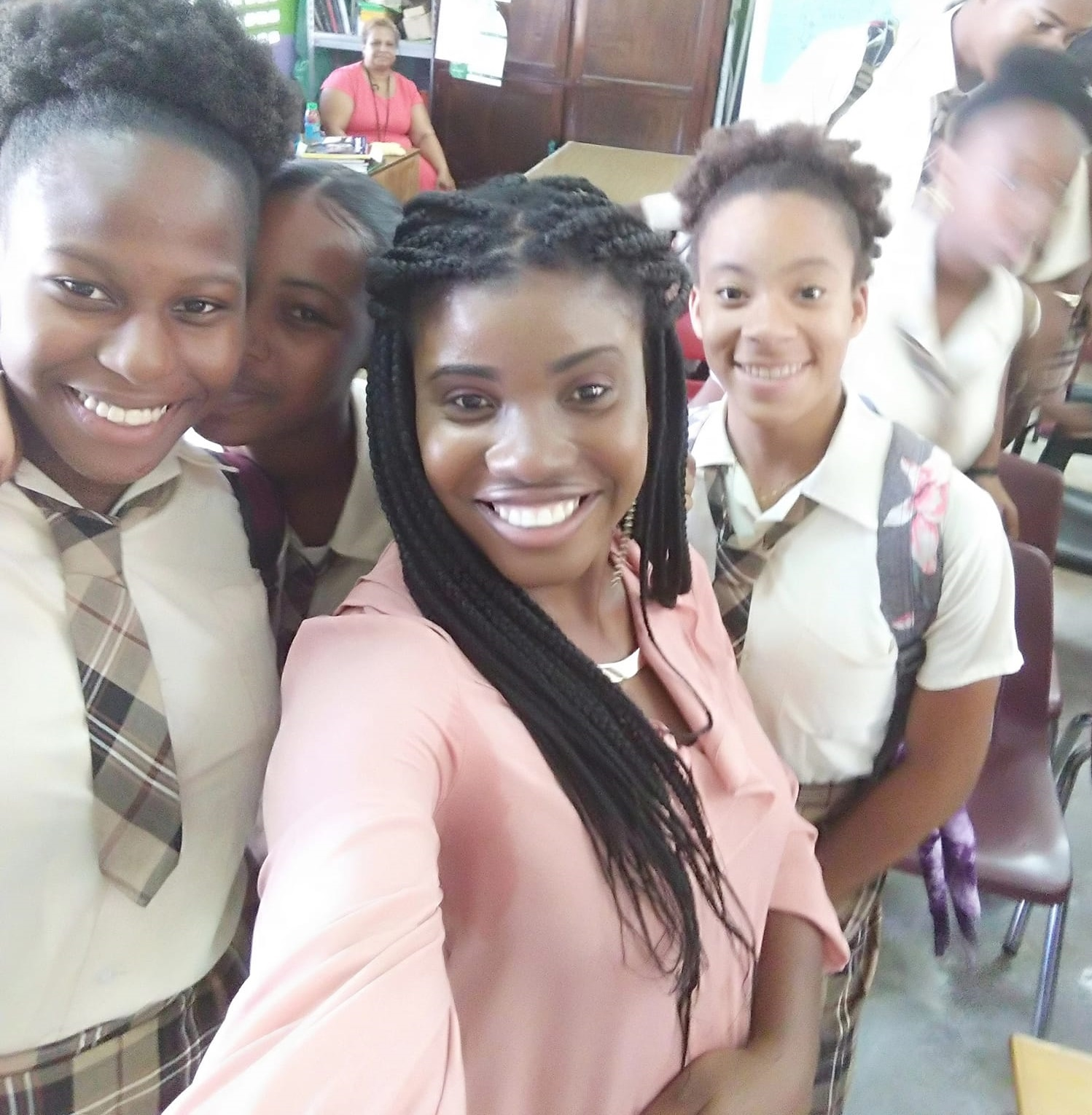 Crystel with a few students after presenting on  Textiles, Clothing and Fashion Industries  at her alma mater, Isaiah Thomas Secondary School.
