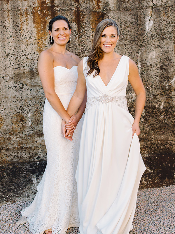 RR_600x800_lgbtq, brides in front of textured wall.jpg