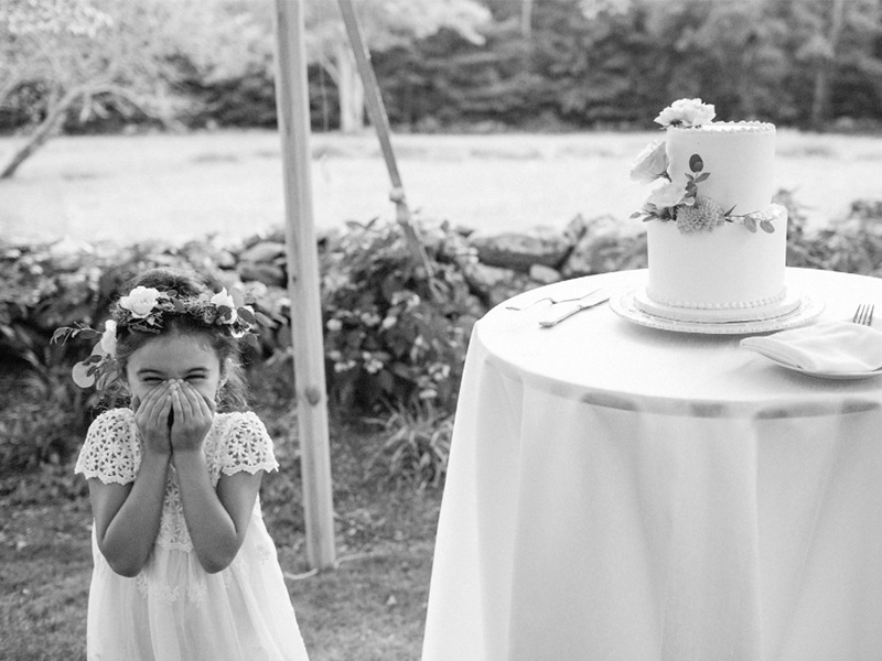 RR_800x600_bw flower girl hands on mouth next to cake.jpg