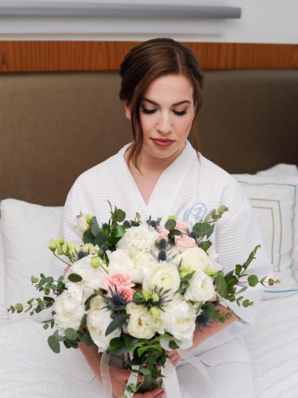 RR_600x800_brunette w large bouquet on bed.jpg