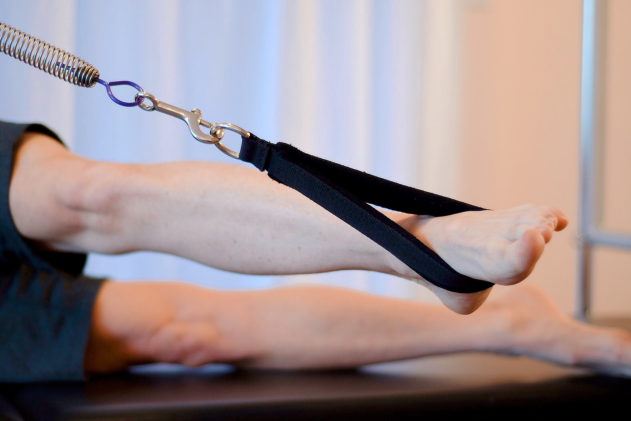 2. Pilatay-Pilates-Feet-In-Straps.JPG
